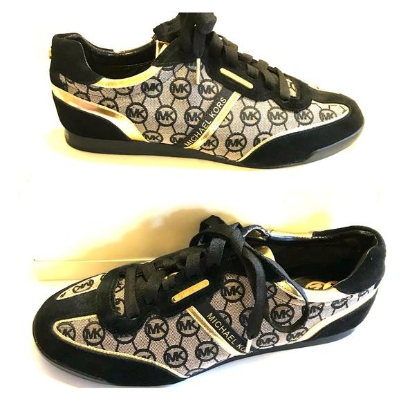 1b706d8a5d47 Michael Kors black and gold sneakers size 11 M. M 5b2fca4b3c984432d13a2642